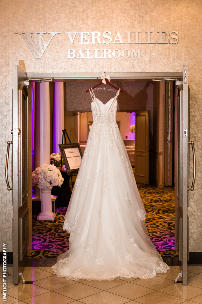 A beautiful wedding dress on display in the lobby of the Versailles Ballroom.