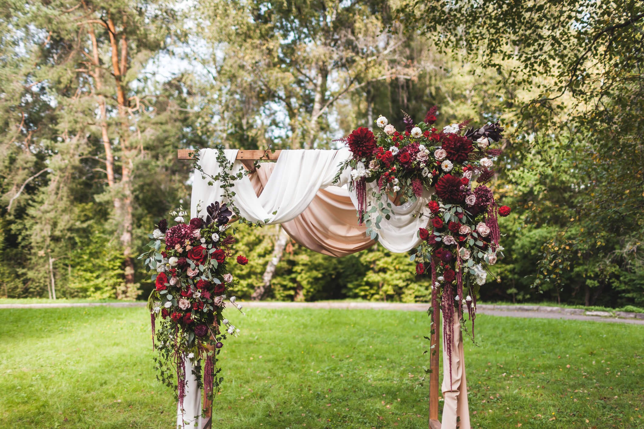 dark red floral wedding ceremony arch