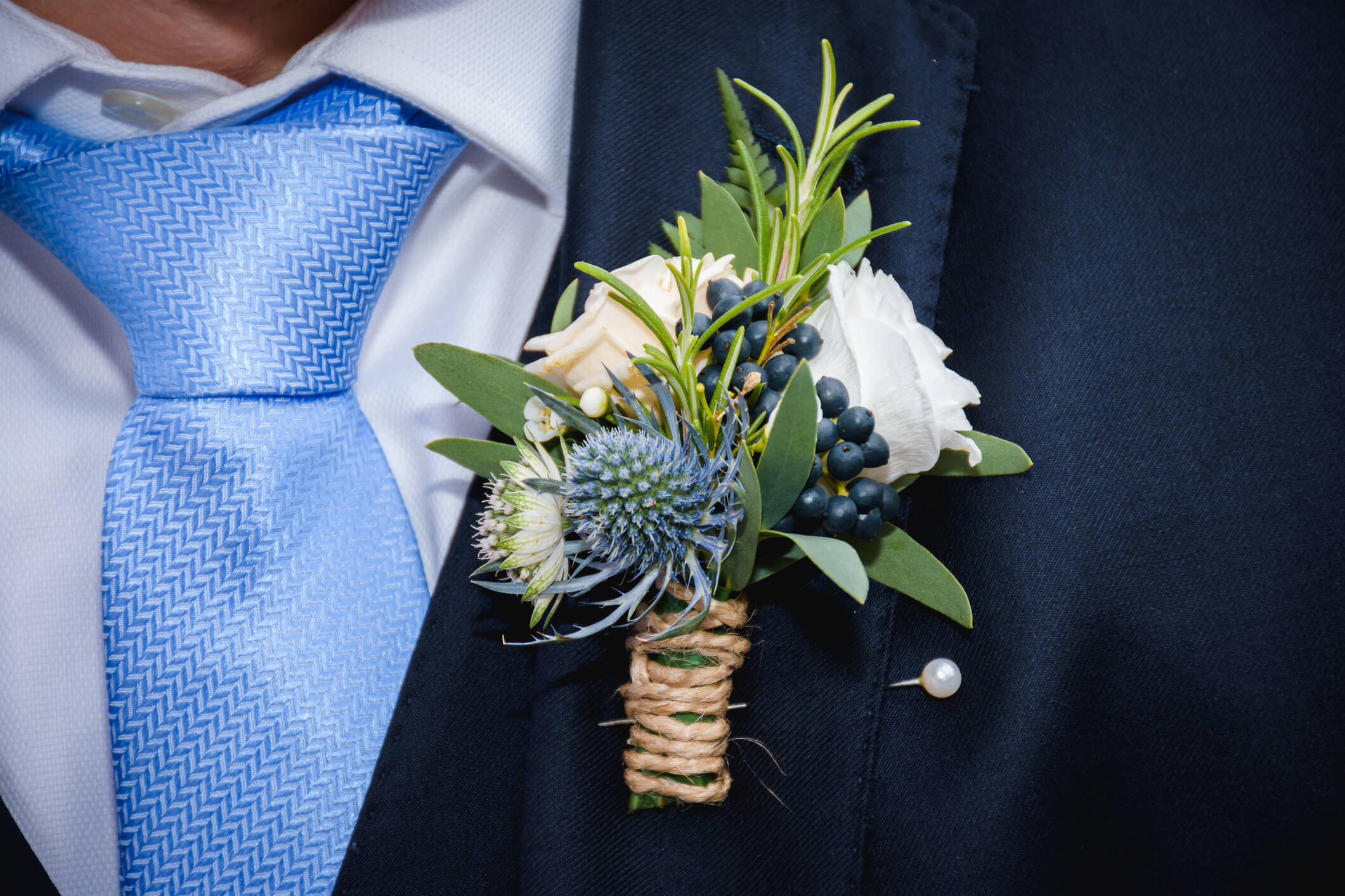 Natural flowers boutonniere in the pocket of the groom