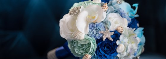 Blue boquet sitting on velvet chair